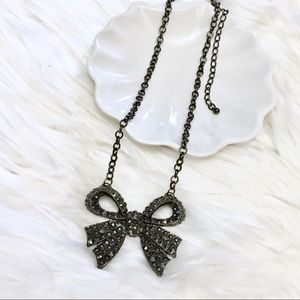 Sweetheart bow rhinestone metal statement necklace